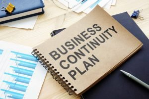 A notebook which says the words Business Continuity Plan